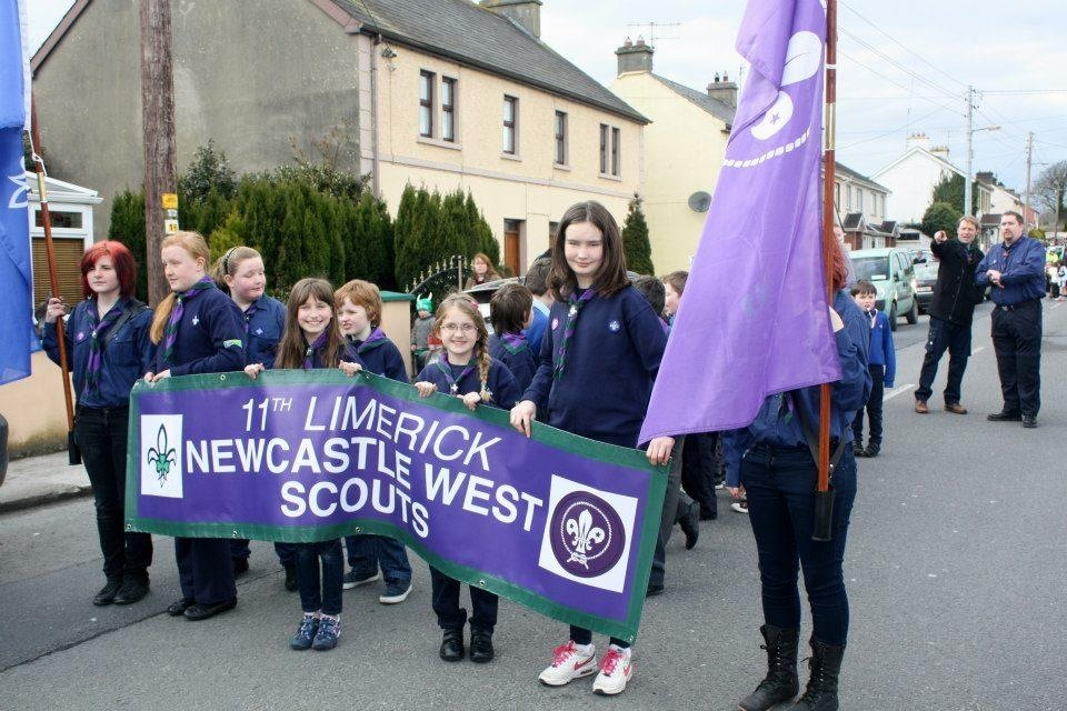 Cub Scouts holding our banner for the parade